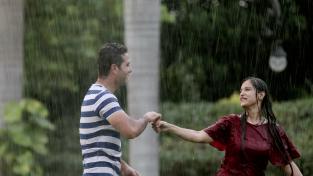 Couple romancing in the rain season, Delhi, India
