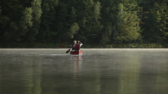 WS Couple rowing a boat in the middle of lake / Stowe, Vermont, United States