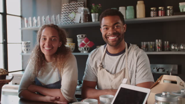 Couple Running Coffee Shop Behind Counter Shot On R3D
