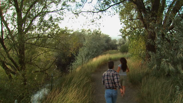couple running down a trail