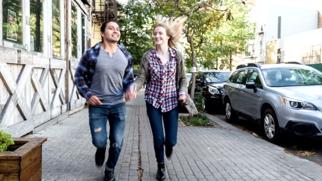 Couple running in the street of New York