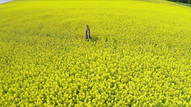 Couple running on oilseed rape field