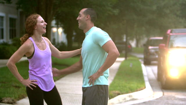 couple running together for exercise - mid adult couple stock videos & royalty-free footage