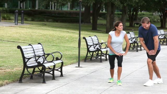 couple running together in the park - mature couple stock videos & royalty-free footage