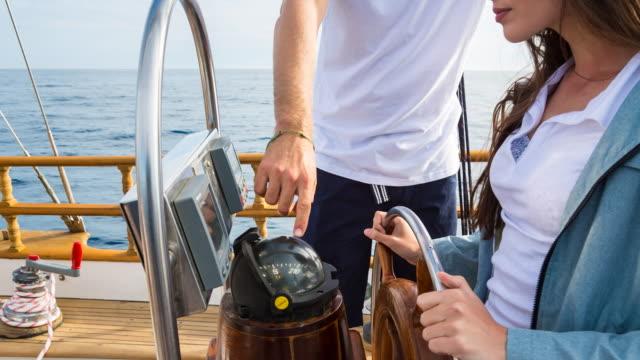 CU couple sailing in mediterranean sea on vintage wooden yacht