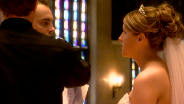 couple saying wedding vows - pastor stock videos & royalty-free footage