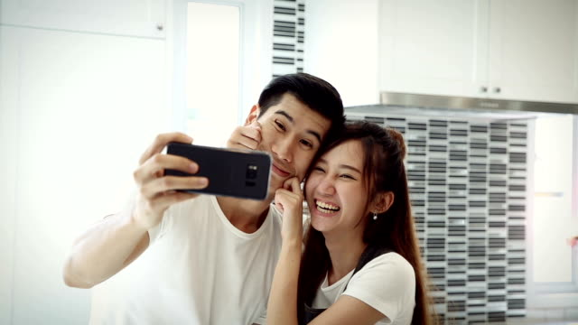 couple selfie in house - falling in love stock videos and b-roll footage