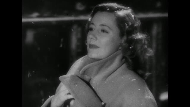1941 couple (irene dunne and cary grant) share a kiss in the snow as she departs on a train and continues traveling - transport conductor stock videos & royalty-free footage