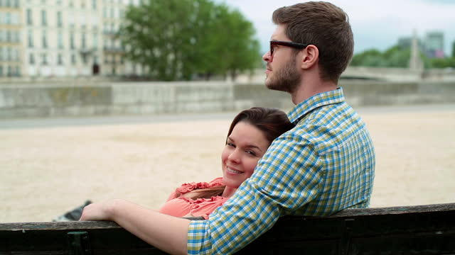 A couple shares a romantic moment while spending time together in Paris.