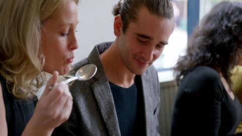 vídeos y material grabado en eventos de stock de ms r/f pan td couple sharing dessert at table in restaurant - vestirse formal