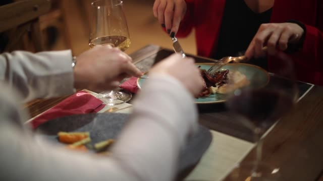 couple sharing food in restaurant - dining stock videos & royalty-free footage