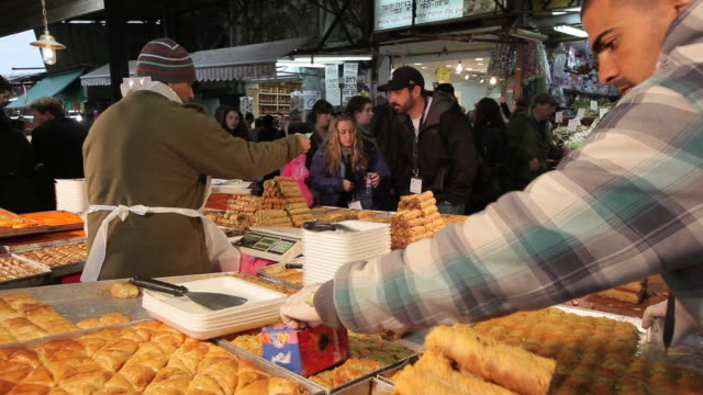 a couple shop at the carmel market in tel aviv, israel. - tel aviv stock videos & royalty-free footage
