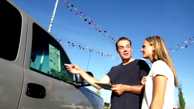 stockvideo's en b-roll-footage met couple shop for a vehicle - sports utility vehicle