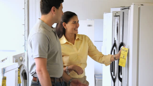 MS TU Couple shopping for new refrigerator in appliance store, Petersburg, Virginia, USA