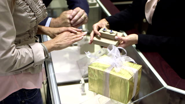 couple shopping for rings in jewelry store - display cabinet stock videos & royalty-free footage