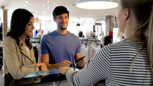 couple shopping in a clothing store - retail occupation stock videos & royalty-free footage
