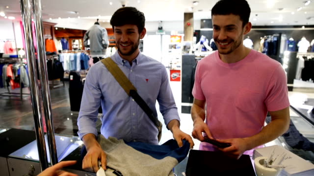 couple shopping in a clothing store - clothes shop stock videos and b-roll footage