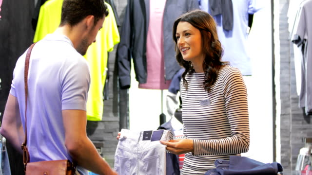 couple shopping in city centre - clothes shop stock videos and b-roll footage