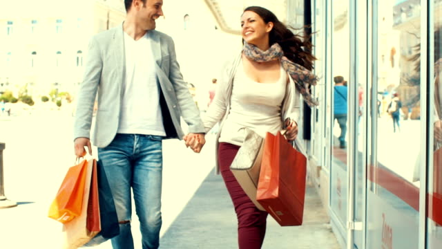 couple shopping in slow motion. - shopping centre stock videos & royalty-free footage