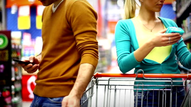 couple shopping in supermarket. - choosing stock videos & royalty-free footage