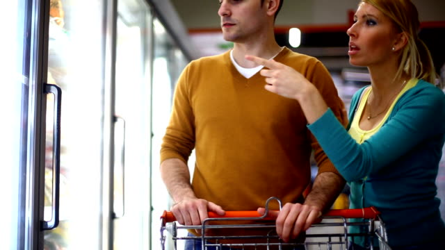 couple shopping in supermarket. - uncertainty stock videos & royalty-free footage