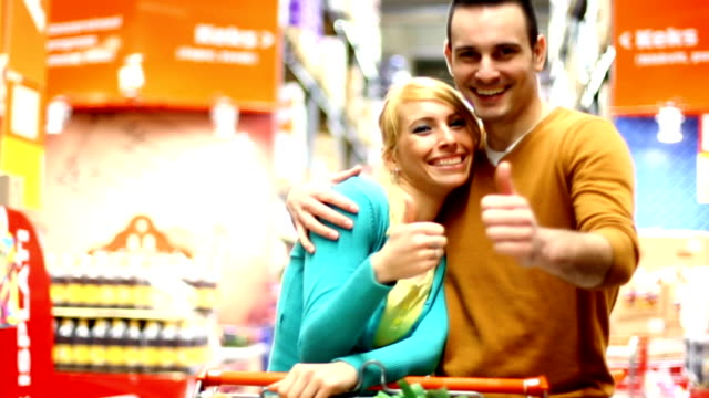 couple shopping in supermarket. - thumbs up stock videos & royalty-free footage