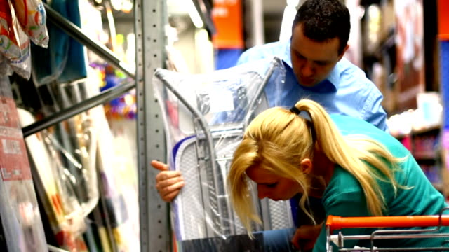 couple shopping in supermarket. - packet stock videos & royalty-free footage