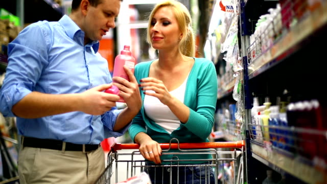 couple shopping in supermarket. - cleaning agent stock videos & royalty-free footage