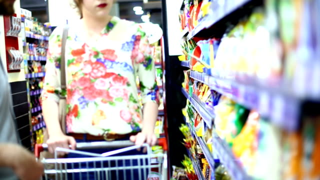 couple shopping in supermarket. - convenience food stock videos and b-roll footage