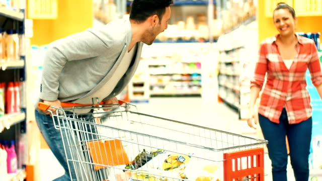 couple shopping in supermarket. - plastic bag stock videos and b-roll footage