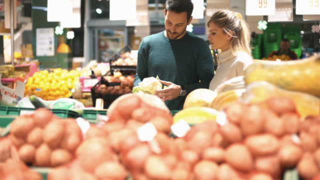 couple shopping in supermarket. - nutrition label stock videos and b-roll footage