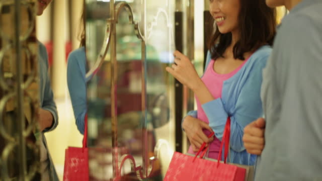 CU Couple shopping together in a shopping mall.