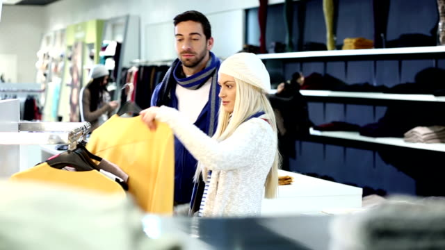 couple shopping together - clothes shop stock videos and b-roll footage