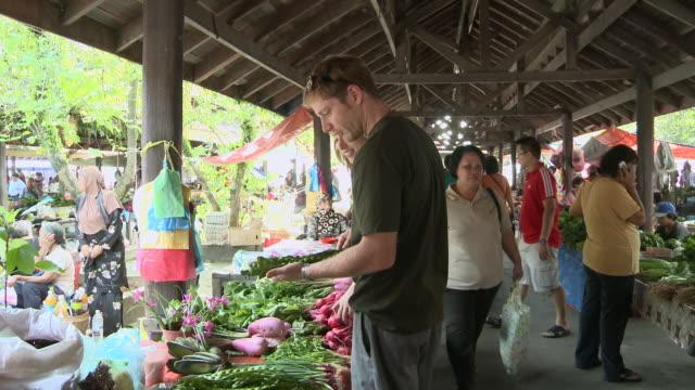 MS Couple Shopping vegetables in market / Kota Kinabalu, Sabah, Malaysia