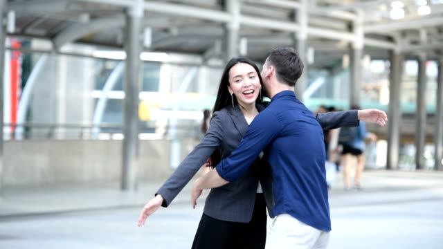 Couple showing greet with affection by hugging