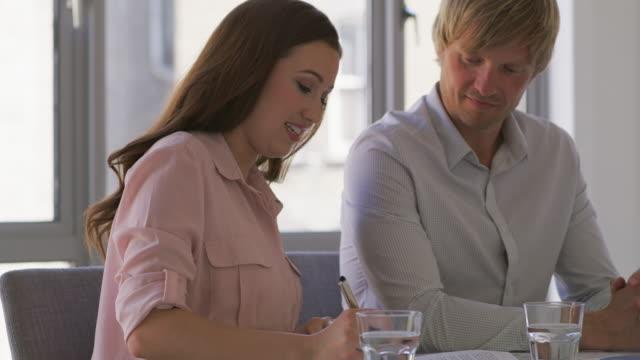 CU A couple sign a financial document