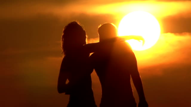couple silhouette on sunset - hugging self stock videos & royalty-free footage