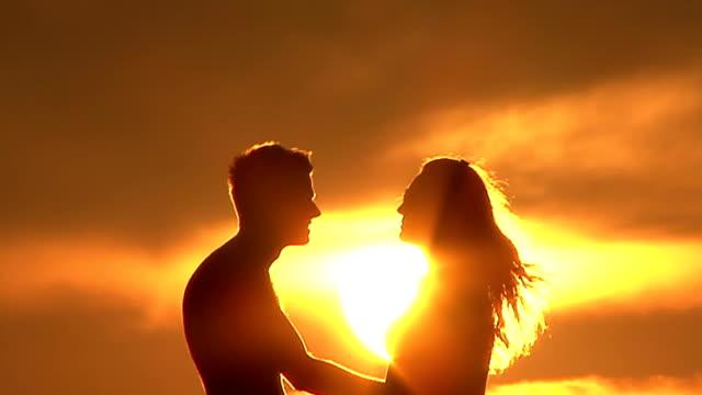 Couple silhouette on sunset