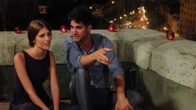 couple sitting and talking - sardinien stock-videos und b-roll-filmmaterial