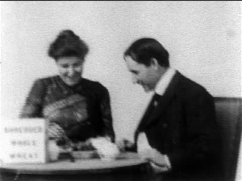 b/w 1904 couple sitting at breakfast table eating shredded wheat biscuit - 1904 stock videos & royalty-free footage