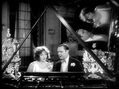 cu, b&w, couple sitting at grand piano, 1920's  - pianist stock videos & royalty-free footage