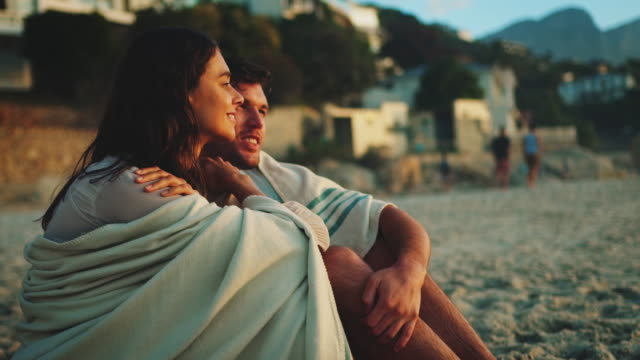 couple sitting at the beach - towel stock videos and b-roll footage