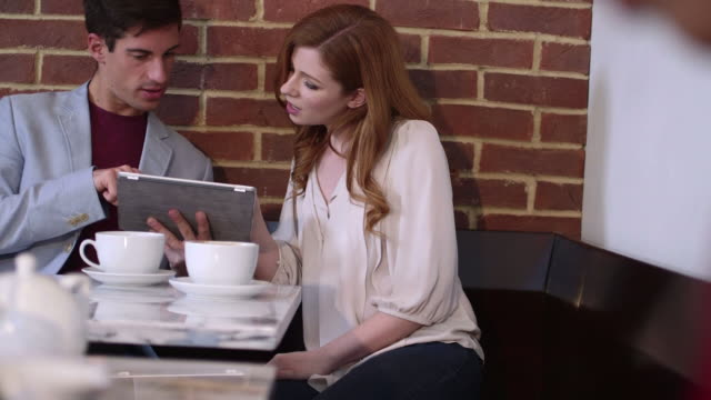 couple sitting in cafã© and discussing - greater london stock videos & royalty-free footage