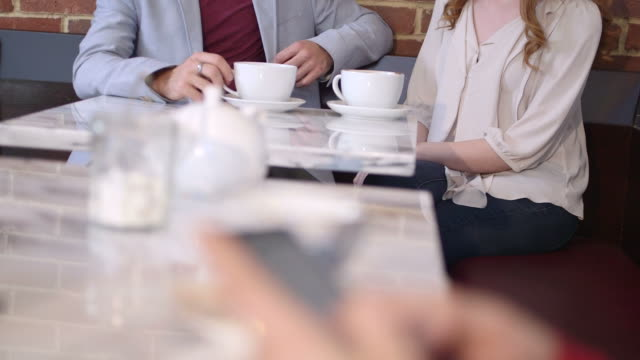 couple sitting in cafã© - greater london stock videos & royalty-free footage