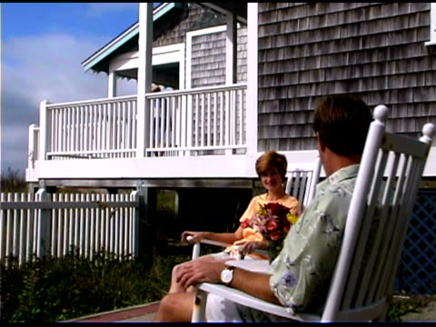 couple sitting in rocking chairs and waving to their children  - see other clips from this shoot 1335 stock videos and b-roll footage