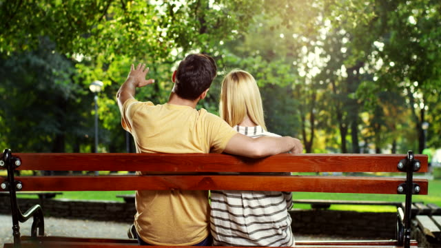 Couple sitting on bench