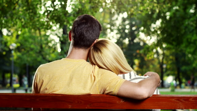 couple sitting on bench - mid adult couple stock videos & royalty-free footage