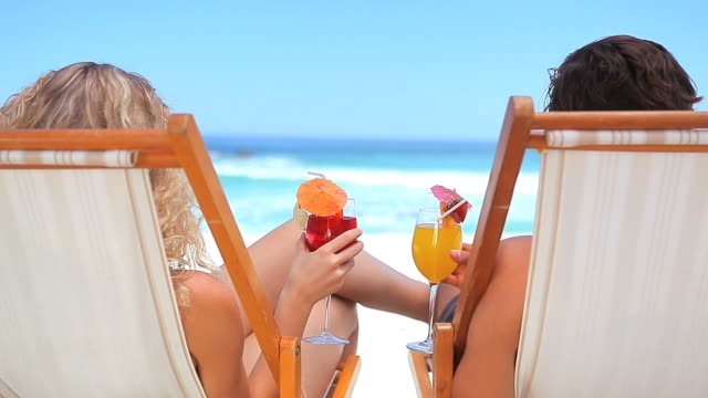 couple sitting with cocktail  - cocktail stock videos & royalty-free footage