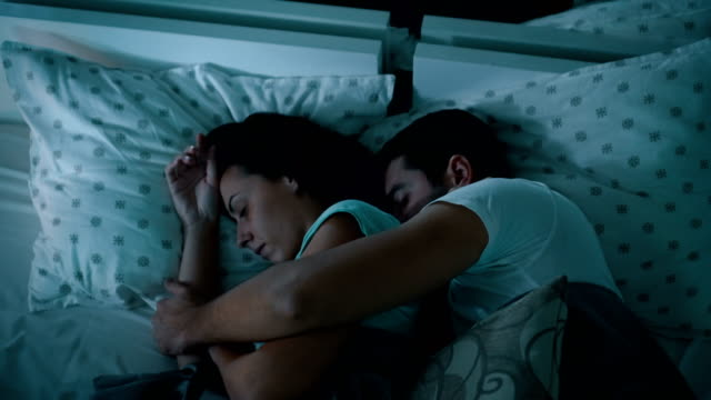 couple sleeping together - sleeping stock videos & royalty-free footage