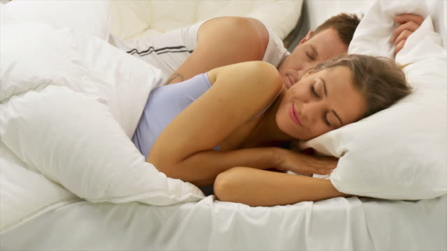 hd dolly: couple sleeping - sleeping stock videos & royalty-free footage